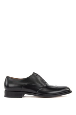 Polished leather Oxford shoes with raised fender-tip detail, Black