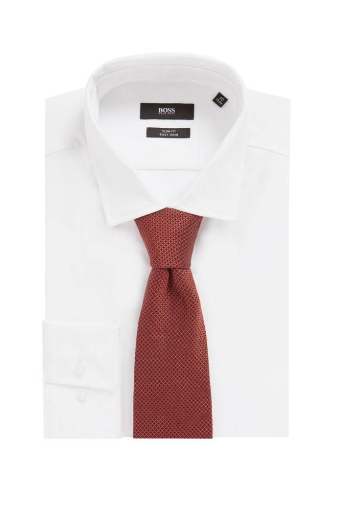 Handmade tie in patterned silk jacquard