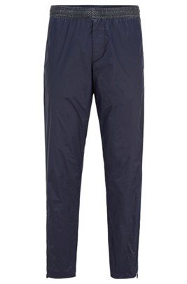 Tapered-fit pants with printed inserts and zipped hems, Dark Blue