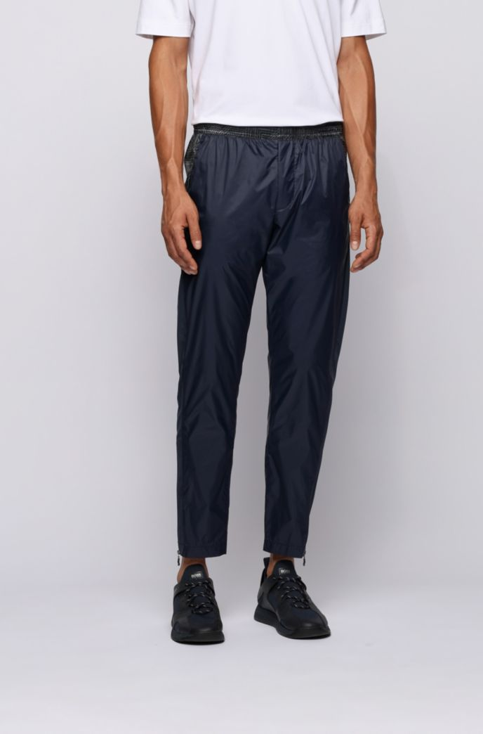 Tapered-fit pants with printed inserts and zipped hems