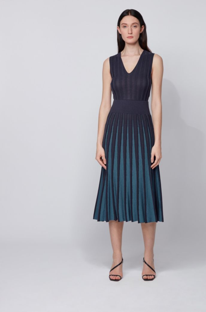 Slim-fit knitted dress with pleated skirt