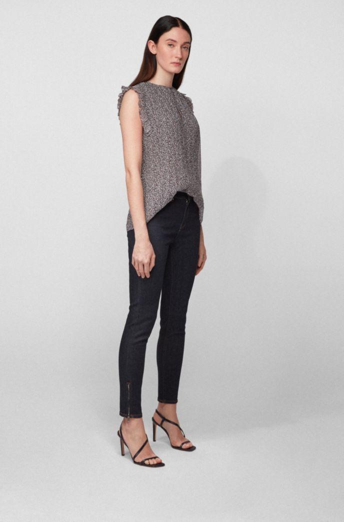 Ruffle-trim sleeveless blouse in dot-print crepe