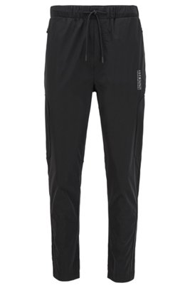 Water-repellent jogging pants with perforated panels, Black