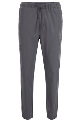 Water-repellent jogging pants with perforated panels, Dark Grey