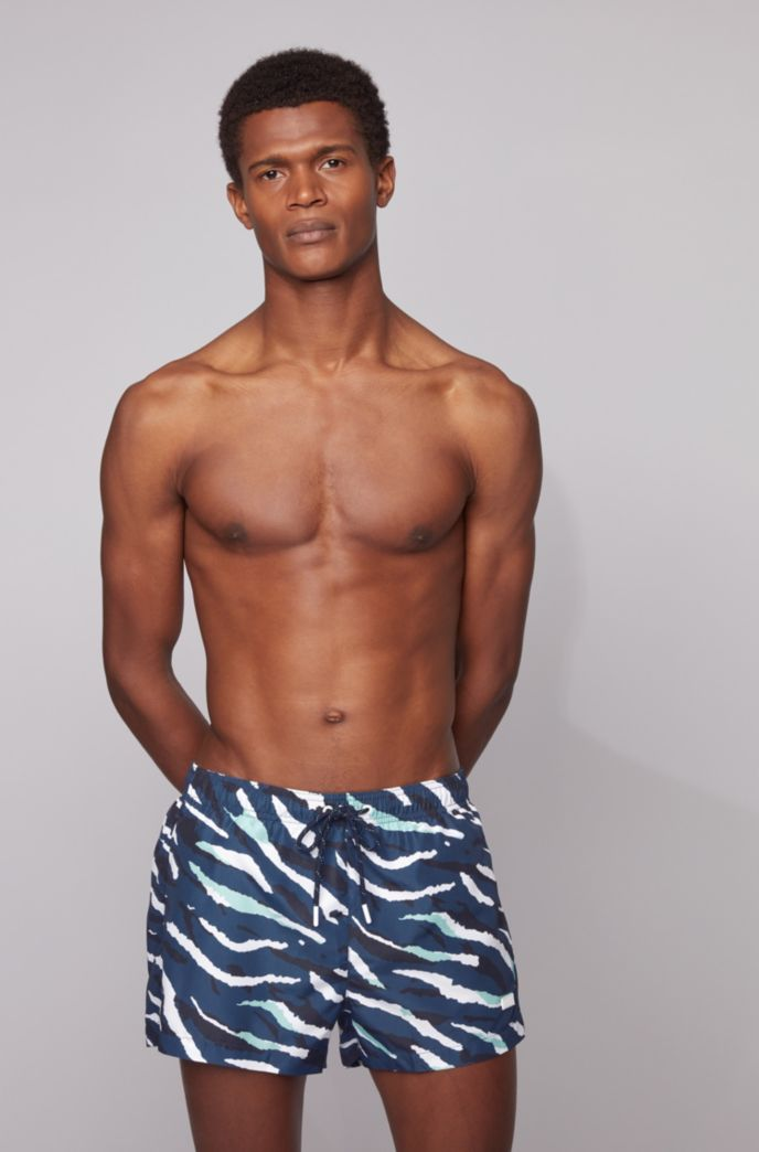 Quick-dry swim shorts with abstract tiger pattern