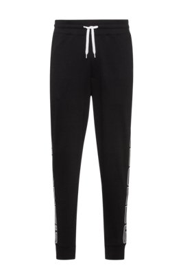 Interlock-cotton jogging pants with logo-tape sides, Black