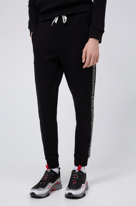 Interlock-cotton jogging pants with logo-tape sides, Black
