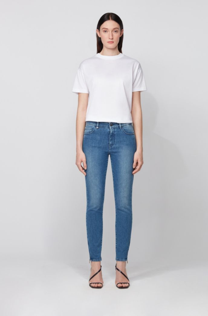 Skinny-fit jeans in stretch denim with zipped hems