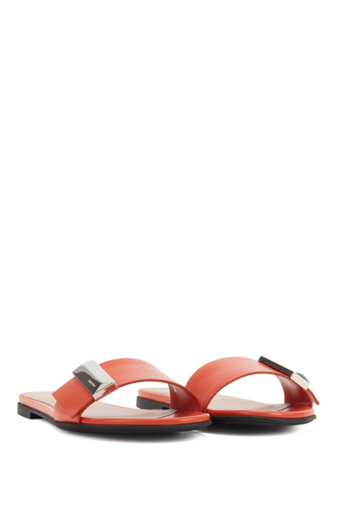 Calf-leather slides with pyramid-shaped metal trim
