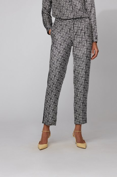Relaxed-fit jogging pants in silk with monogram print, Patterned