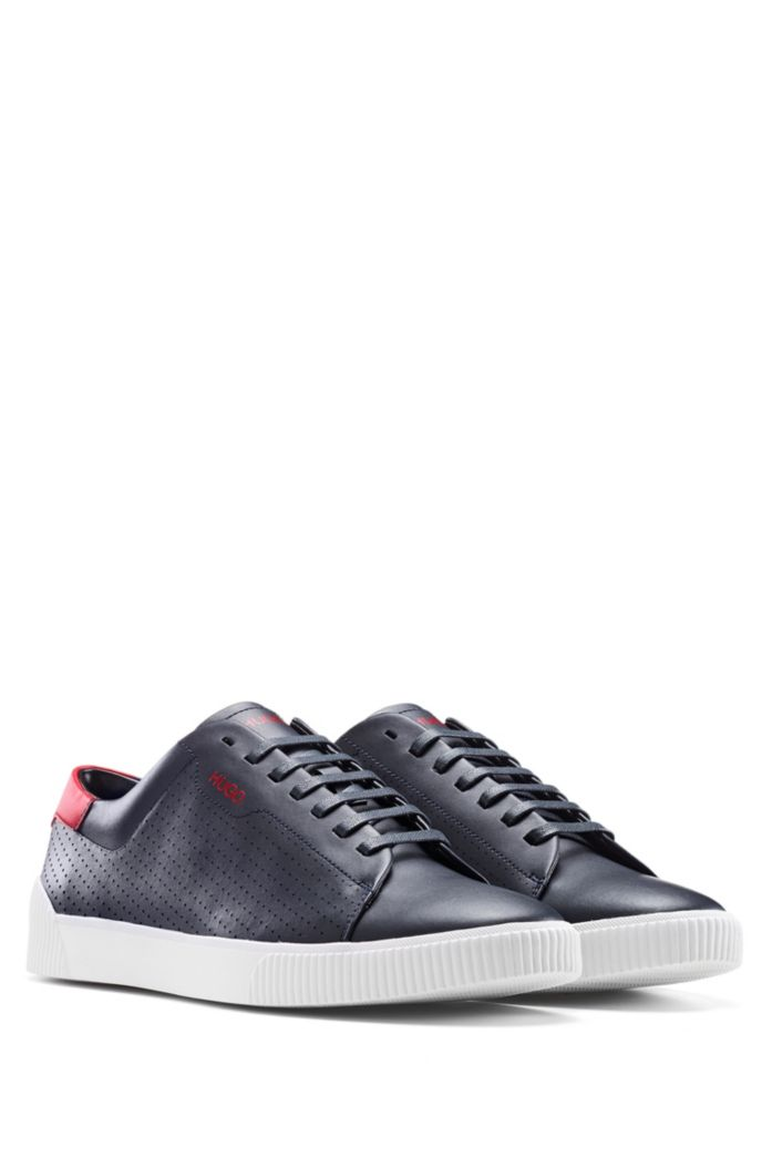 Lace-up sneakers in nappa leather with perforated details