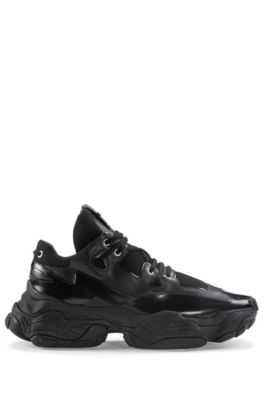 Chunky sneakers in brush-off leather and mesh, Black