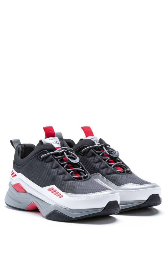 Baskets inspirées des chaussures de course, avec détails colorés