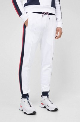 Unisex jogging pants with side stripes and double waistband, White