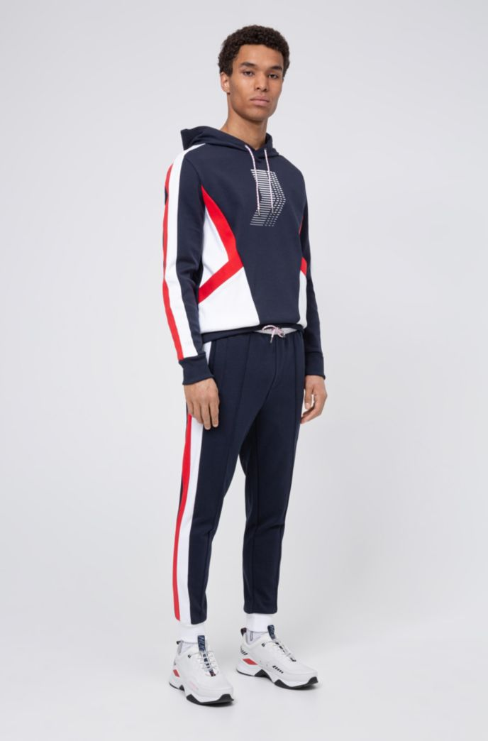Unisex jogging pants with side stripes and double waistband