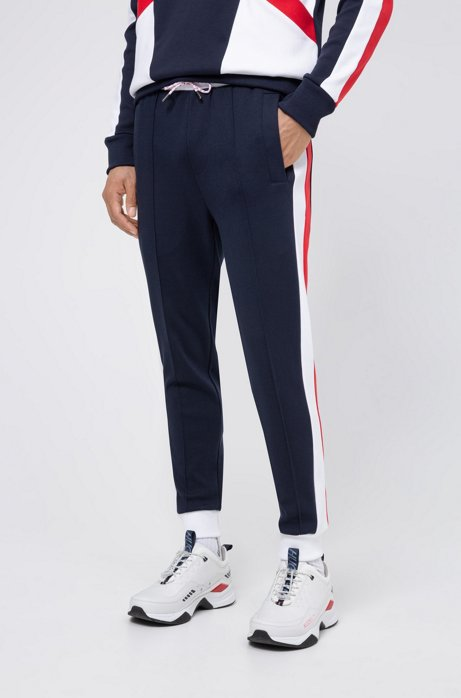 Unisex jogging pants with side stripes and double waistband, Dark Blue
