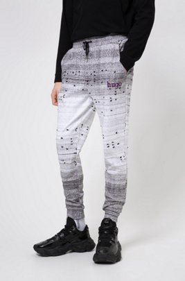 Unisex jogging pants with all-over print, White