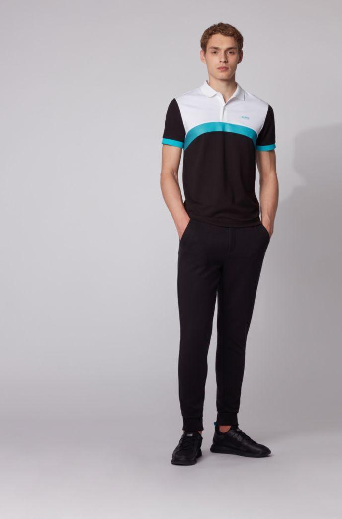 Polo Slim Fit à rayures color block incurvées