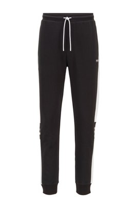 Jogging pants in double-faced jersey with logo details, Black