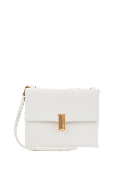 Cross-body bag in coated leather with pyramid hardware, White