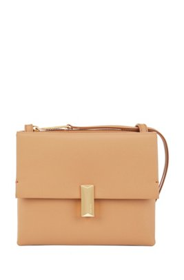 Cross-body bag in coated leather with pyramid hardware, Brown