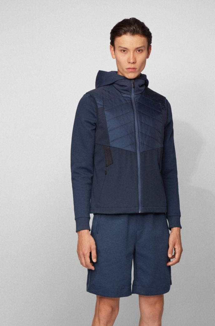 Water-repellent gilet with padding and reflective details