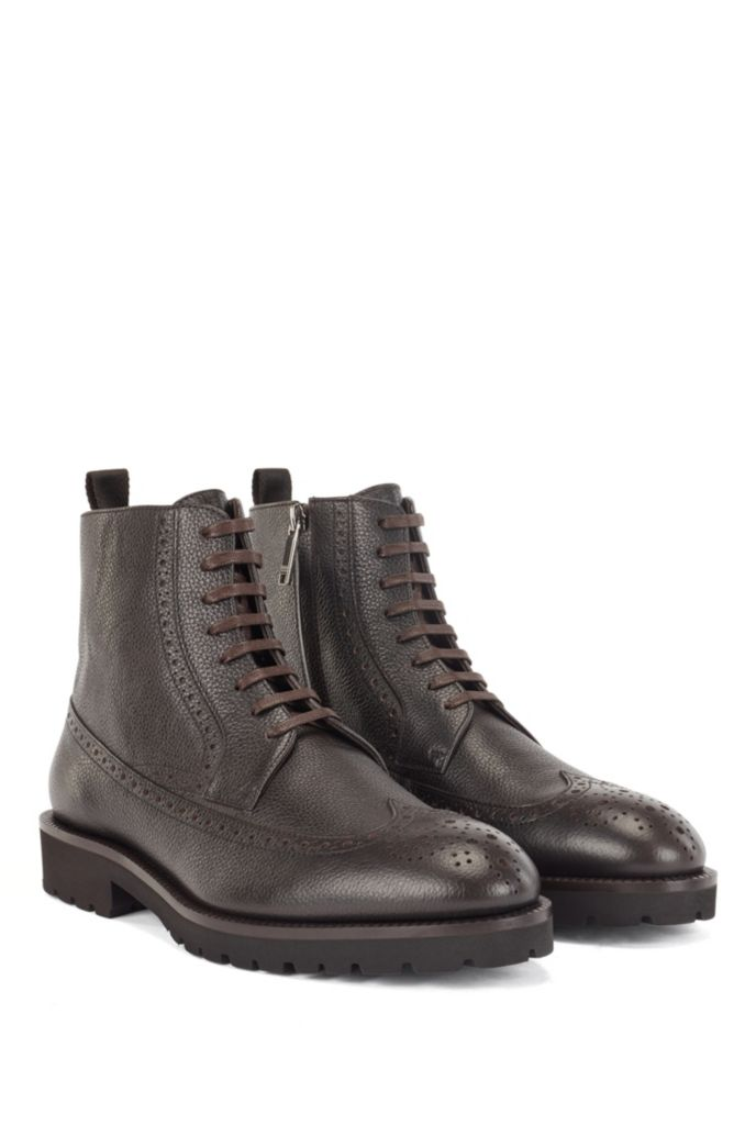 Lace-up boots in calf leather with brogue details