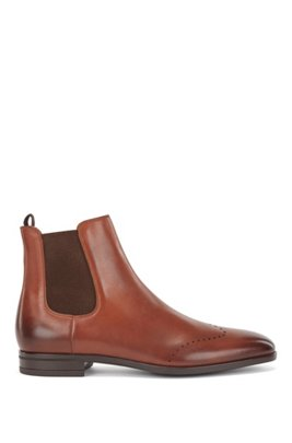 Chelsea boots in burnished leather with lasered details, Brown