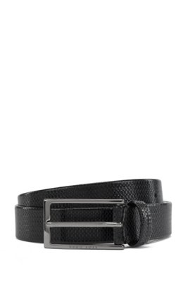 Monogram-embossed belt in vegetable-tanned leather, Black