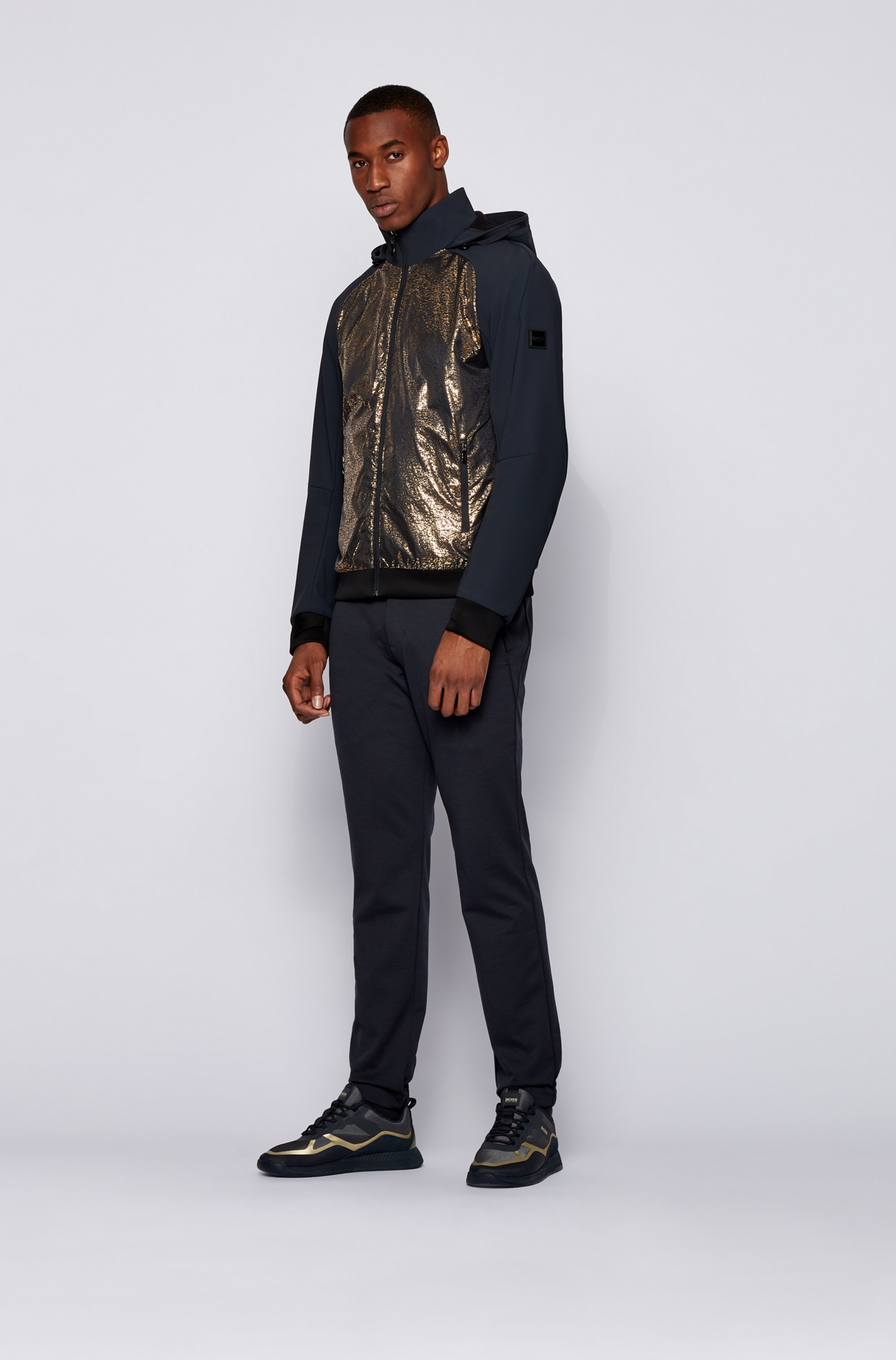 Water-repellent hooded jacket with hybrid outer