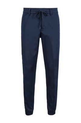 Tapered-fit tracksuit bottoms in water-repellent fabric, Dark Blue