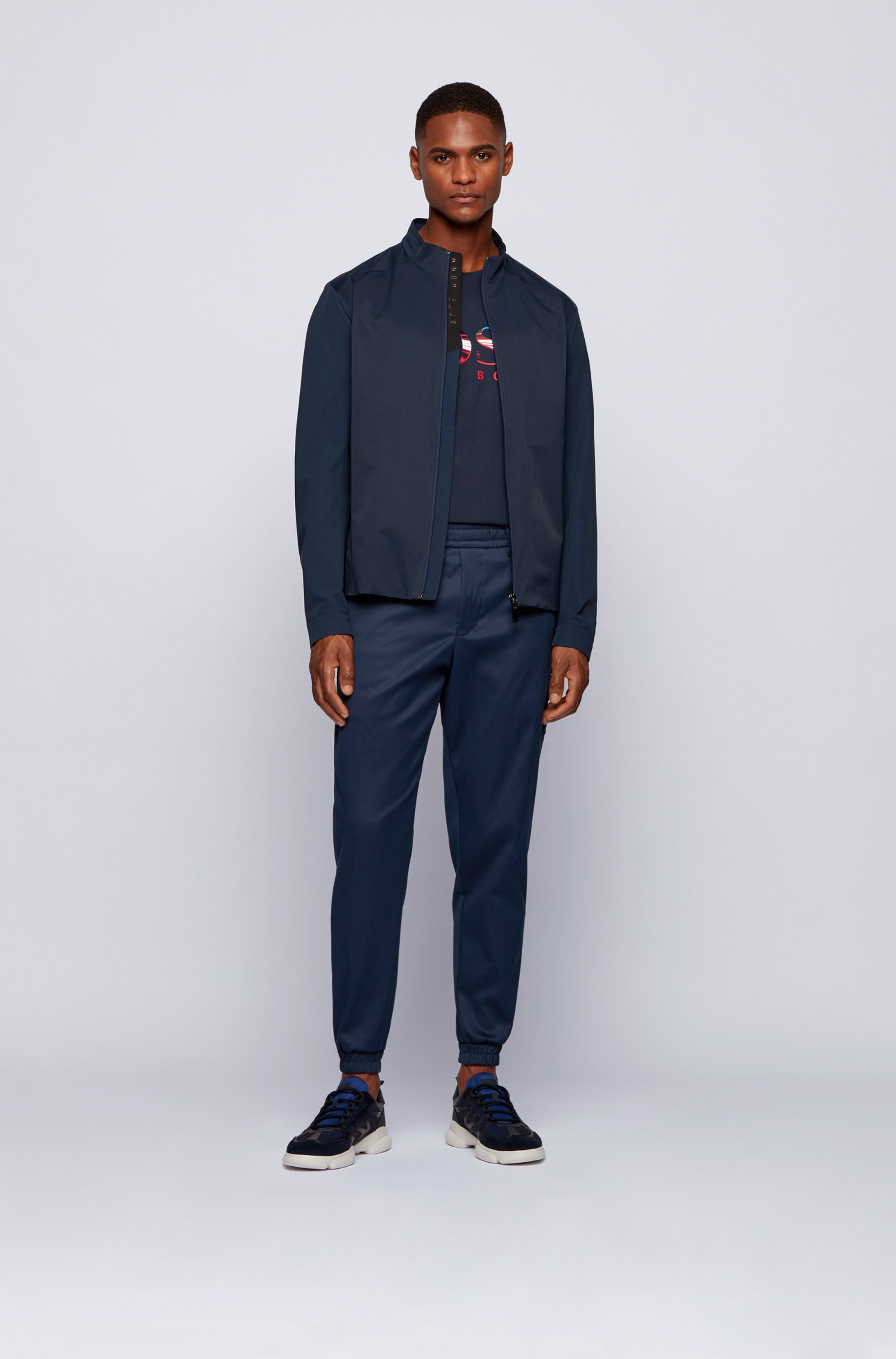 Tapered-fit tracksuit bottoms in water-repellent fabric