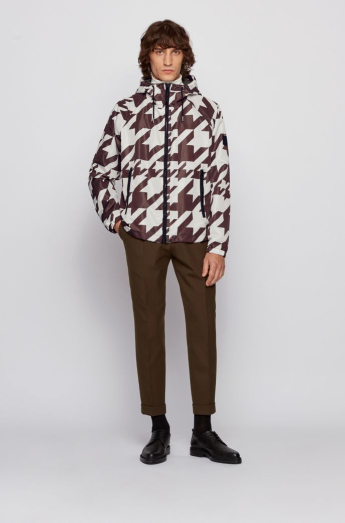Packable windbreaker jacket with all-over motif