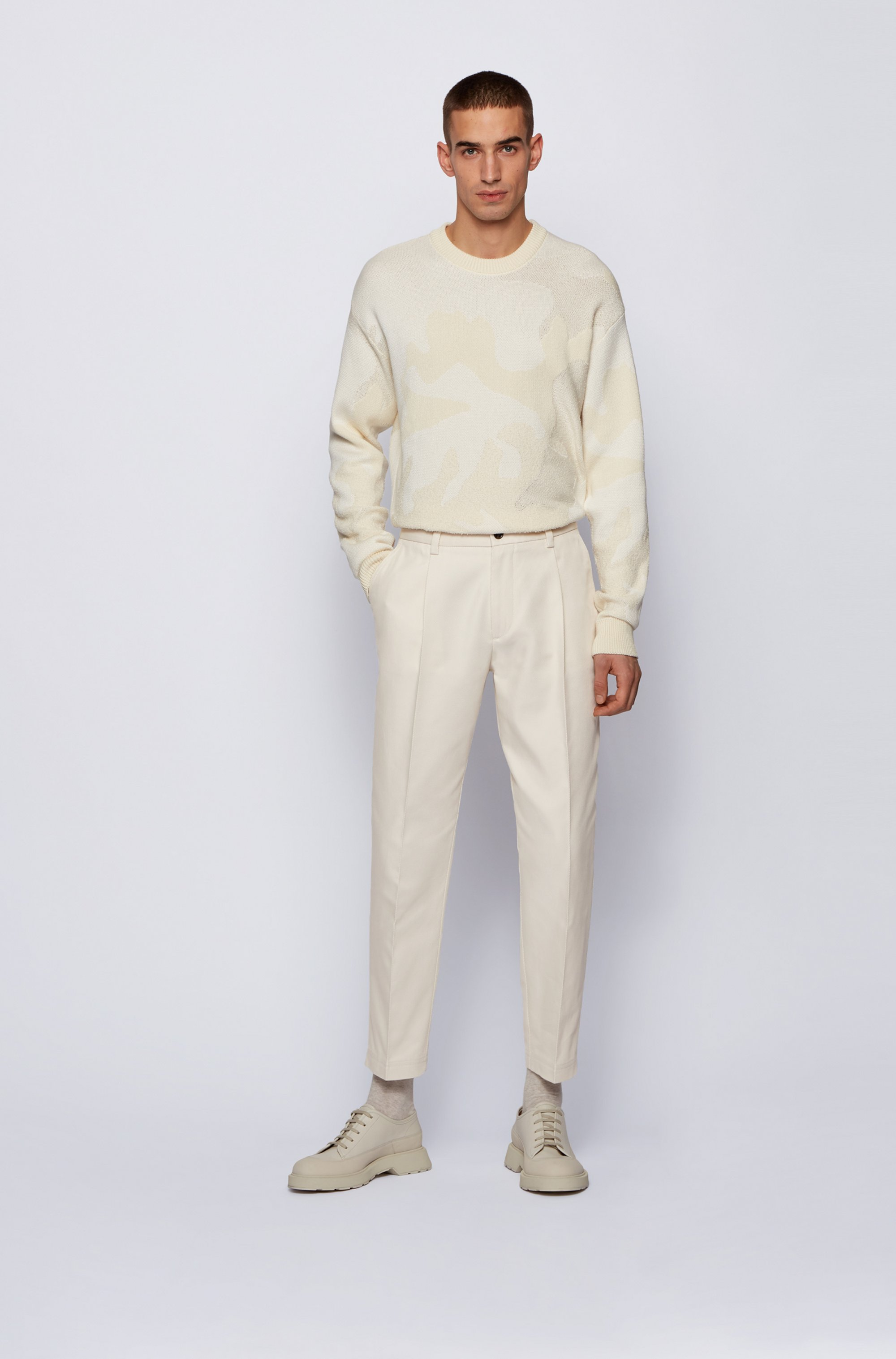 Pleated relaxed-fit pants in an Italian cotton blend