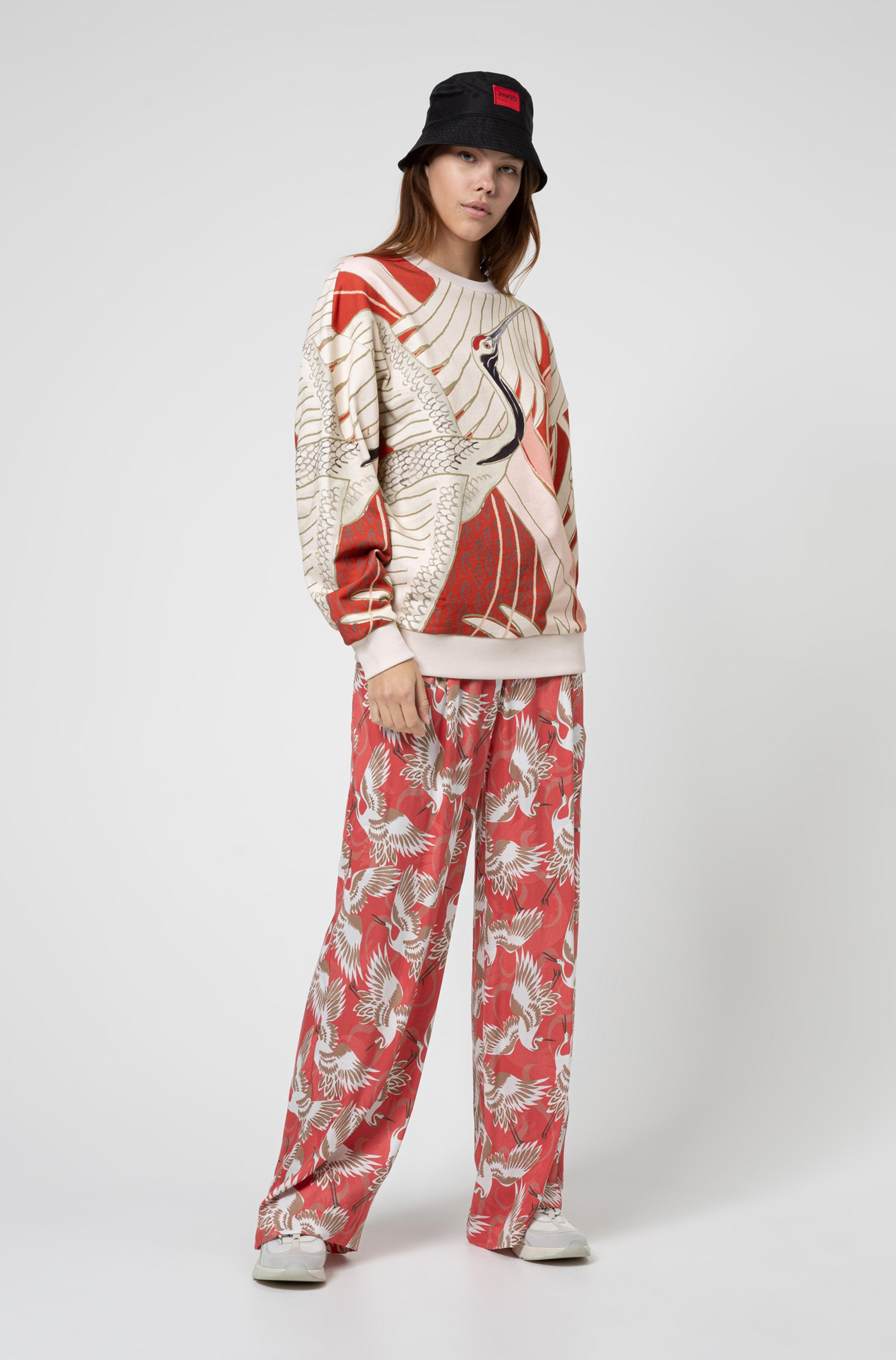 Relaxed-fit flared pants in crane-print fabric