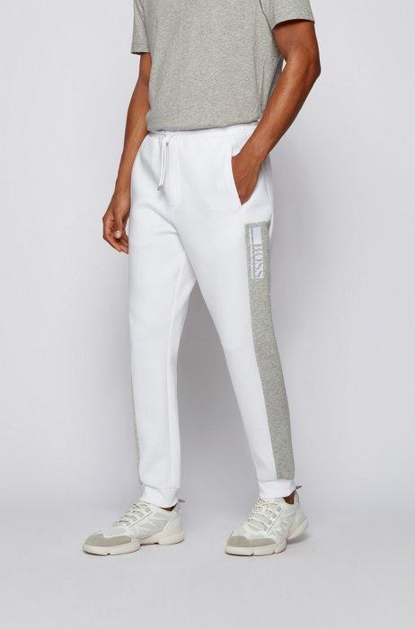 Bas de survêtement resserré au bas des jambes avec logo color block, Blanc