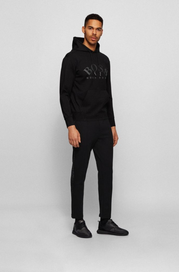 Relaxed-fit tracksuit bottoms with collection-themed reflective artwork