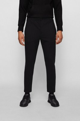 Relaxed-fit tracksuit bottoms with collection-themed reflective artwork, Black
