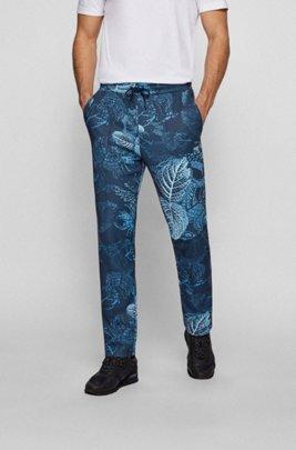 Regular-fit tracksuit bottoms with botanical print, Dark Blue