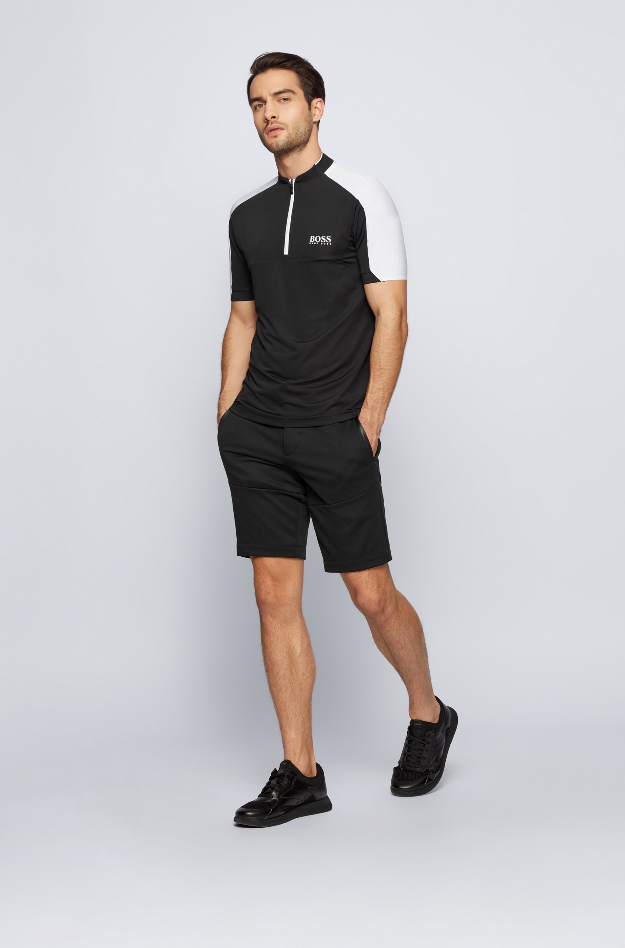 Zip-neck logo polo shirt in performance-stretch fabric