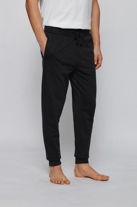 Cuffed-hem loungewear pants with heat-sealed logo artwork, Black