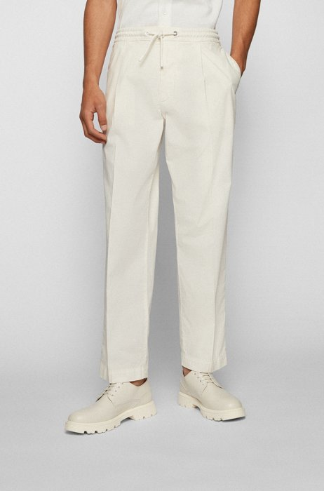 Pleat-front pants in paper-touch stretch cotton, White