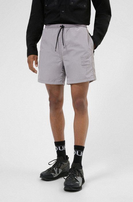 Relaxed-fit shorts with zipped pockets and manifesto print, Silver