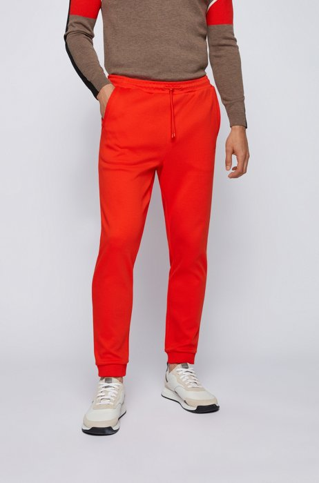 Cuffed tracksuit bottoms in cotton with tonal piqué structure, Orange