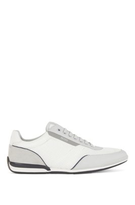 Low-top trainers in mesh with rubberized trims, White