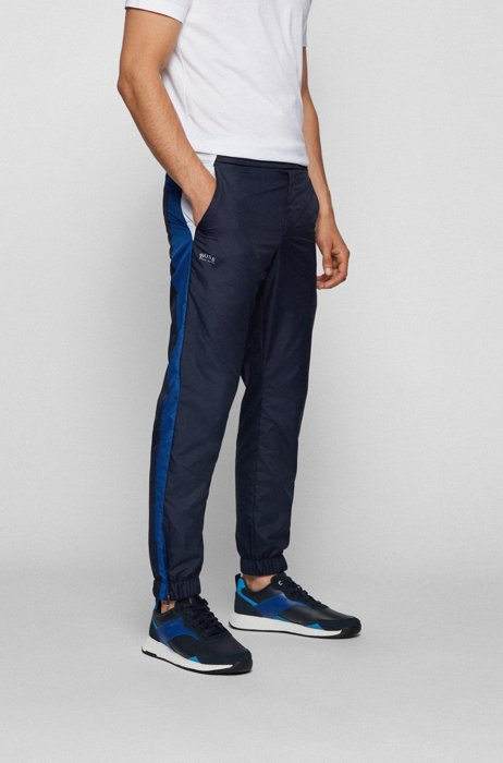 Water-repellent tracksuit bottoms in recycled material, Dark Blue