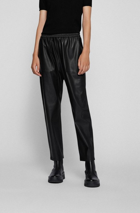 Relaxed-fit tracksuit bottoms in faux leather, Black