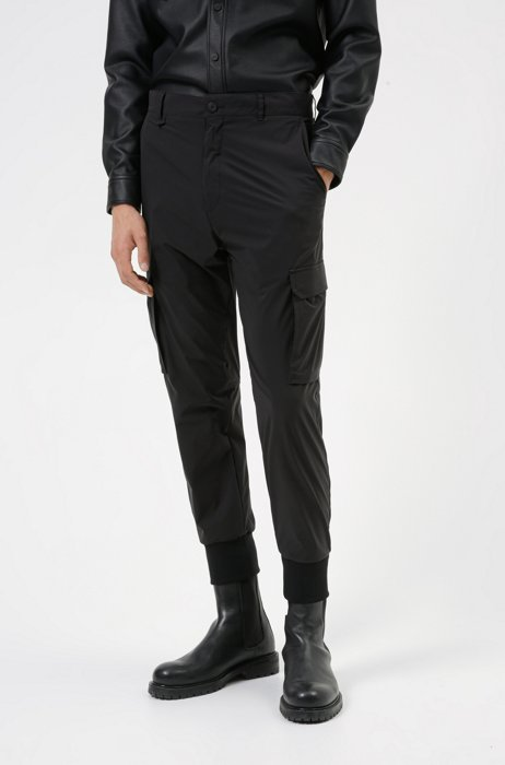 Cuffed slim-fit cargo pants in performance fabric, Black