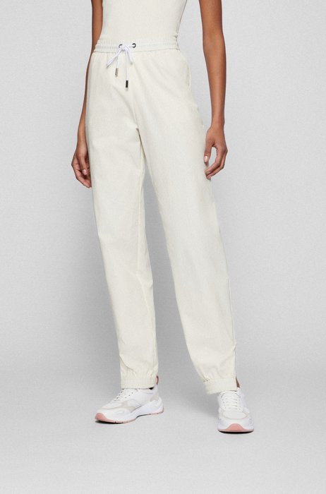 Relaxed-fit pants with cuffed zipped hems, White