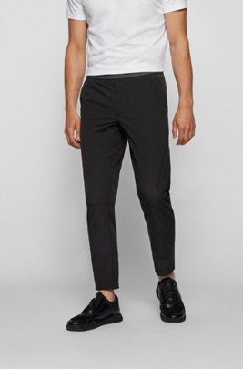 Water-repellent tapered-fit pants with elasticated waistband, Black